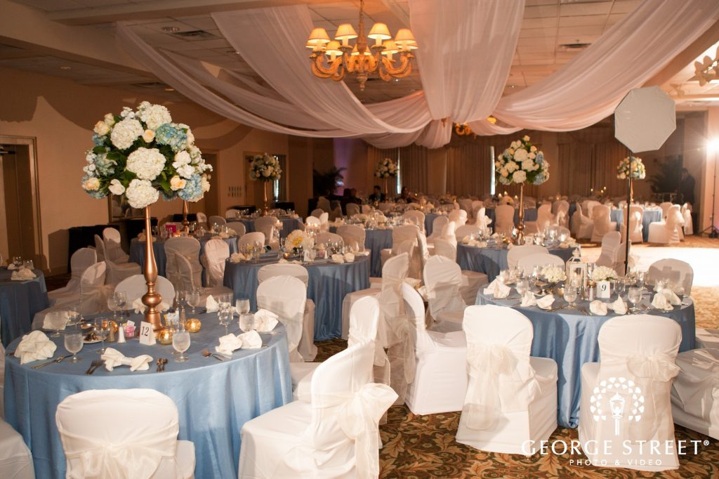 Rose of sharon florist weddings archives rose of sharon wedding the tall centerpieces were created on gold stands using a variety of flowers in white light blue and light yellow junglespirit Choice Image